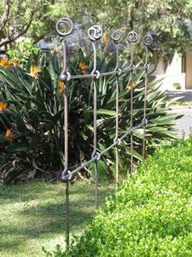 Garden trellis wrought iron timber wire trellis ideas for Wire garden trellis designs